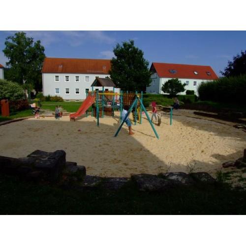 Bild 1: Sandspielplatz im Wohngebiet